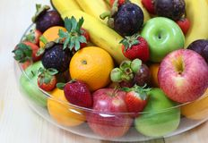 Tropical fresh fruits. Tropical assorted fresh fruits in a glass display bowl royalty free stock photography