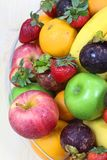 Tropical fresh fruits. Tropical assorted fresh fruits in a glass display bowl stock photo