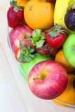 Tropical fresh fruits. Tropical assorted fresh fruits in a glass display bowl stock photography