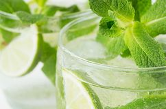 Free Tropical Fresh Green Cold Cocktail Closeup With Mint, Lime, Ice, Straw, Water Drops, Bubbles, Blur. Royalty Free Stock Photo - 117200945