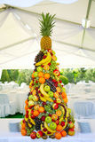 Tropical fruit. Pyramid with tropical fruit on the wedding banquet Stock Images