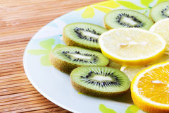 Tropical fruit. Cut by rings on a plate Royalty Free Stock Photos