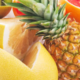 Tropical fruit. Close up of tropical fruit (pineapple kiwi, pomelo lemon grapefrut Royalty Free Stock Photo