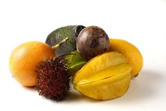 Tropical fruit. Various tropical fruit - grenadilla, starfruit, avocado, lemon, maracuja, rambutan litchi stock images