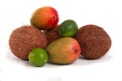 Tropical Fruit. Mangos, limes and coconuts on a white background Stock Photos