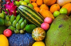 Tropical fruit background. Raw and ripe exotic fruit closeup photo. Vegetarian wallpaper.