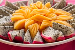 Tropical fruit Dragon fruit and cantaloupe melon carve.  Royalty Free Stock Images