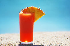 A tropical fruit drink on the beach Stock Photo