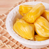 Tropical fruit Jackfruit jakfruit, jack, jak. In bowl on wooden table. Selective focus Royalty Free Stock Images