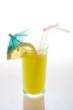 Tropical Fruit juice. In glass with straws and umbrella Stock Images