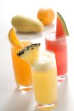 Tropical fruit juice. Orange juice, watermelon juice, pineapple juice, the tropical fruits are together Stock Photos