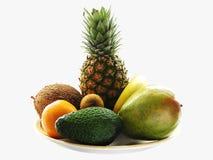 Tropical fruit-piece. Fruit-piece. Ananas, Avokado, orange, mango, banan, coconut, kiwi Stock Images