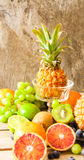 tropical fruit, pineapple, kiwi, red orange and blueberries Royalty Free Stock Photos