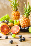 tropical fruit, pineapple, kiwi, red orange and blueberries Stock Image