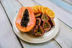 Tropical fruit plate. Tropical exotic fruit plate on wooden background Stock Photo
