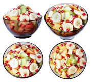Tropical fruit salad, a bowl of dark glass, isolate. Royalty Free Stock Photo