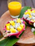 Tropical fruit salad in pitahaya, dragon bowls with mango juice. Royalty Free Stock Photo
