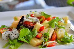Tropical fruit salad in white plate . Thailand style royalty free stock photo