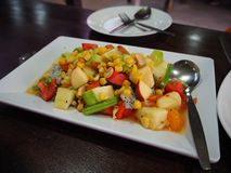 Tropical fruit salad in white plate . stock photos