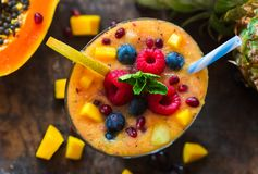 Tropical fruit smoothie. With papaya, pineapple and mango Stock Photography