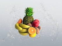 Tropical fruit with splashing water Stock Photos