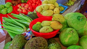 Tropical fruit vegetables on counter of street market vendor stock video footage