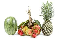 Tropical Fruit. Watermelon, rambutan and pineapple isolated on white background. Watermelon, rambutan and pineapple isolated on white background Stock Photo