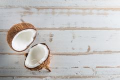 Tropical fruit whole and half abstract background .Coconut on white wood background. from top view royalty free stock image