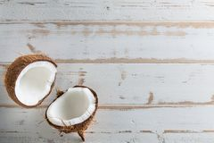Tropical fruit whole and half abstract background .Coconut on white wood background. from top view royalty free stock photo