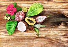 Tropical fruit on wooden background. Top view. Summers background Stock Photography