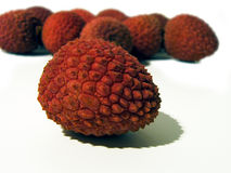 Tropical fruits. Isolated tropical fruits called lichi. Selective focus used to emphasize the main element Stock Images