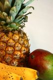 Tropical Fruits. (pinapple, mango and banans) isolated on white, close up Stock Image