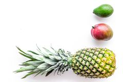 Tropical fruits background. Pineapple and mango on white background top view copyspace Royalty Free Stock Photos