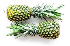 Tropical fruits background. Pinneapple on white top view Stock Photography