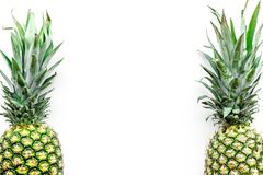 Tropical fruits background. Pinneapple on white top view copyspace Royalty Free Stock Photos