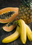 Tropical fruits. Bananas, papaya and pineapple Stock Image