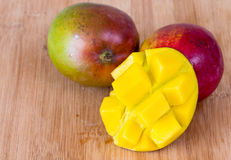 Tropical Fruits: Beautiful Mangos in Wooden Board Royalty Free Stock Images