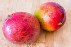 Tropical Fruits: Beautiful Mangos in Wooden Board Stock Images