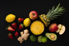 Tropical fruits on black background Stock Photo