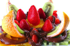 Tropical fruits with chocolate Royalty Free Stock Images