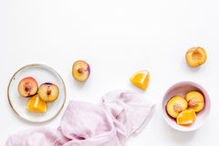 Tropical fruits design with orange and peach on fabric white table background top view mock up Royalty Free Stock Images