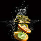 Tropical fruits fall underwater Stock Photo