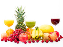 Tropical fruits with fruit juices Royalty Free Stock Photos