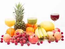 Tropical fruits with fruit juices Royalty Free Stock Photo