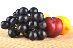 Tropical fruits. fruits isolated. Tropical fruits. grape apple orange isolated Stock Photography