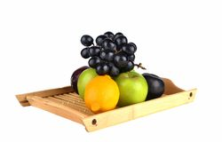 Tropical fruits. fruits isolated. Tropical fruits. grape apple orange isolated Stock Photos