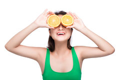 Tropical fruits. Healthy eating. Charming young asian woman hold Stock Photography