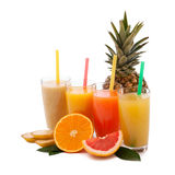 Tropical fruits and juice isolated on white Stock Images