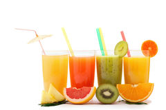 Tropical fruits and juice isolated on white Stock Photos