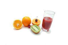 Tropical fruits and juice. Rape orange, kiwi, cherry and glass of juice medium-sized on white background Stock Photography